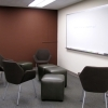 Seating area with whiteboard for group study.