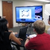 Students utilizing the mobile monitor in the collaboration space.