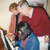 Submitted by P. Heuveline: Sam Preston, Linda Aiken and Melodie Simond, Potluck dinner at Preston's, Fall 1995